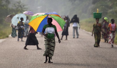 Democratic Republic of the Congo, Walikale, people walk on a street during th 2011 presidential elections.