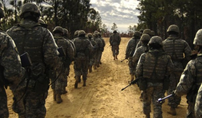 U.S. Army recruits practice patrol tactics while marching during U.S. Army basic training at Fort Jackson, S.C., Dec. 6, 2006