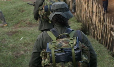 Colombia, 2010: Mountains in the Valle del Cauca region, between Santander de Quilichao et Popayan. FARC-EP (Revolutionary Armed Forces of Colombia) combattants walking next to native houses.