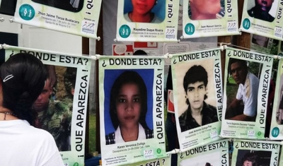 Wall with photo of disappeared in Mexico