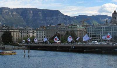 Mont-Blanc bridge in Geneva with red Cross' flags