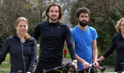 The four LLM students with their bicycle