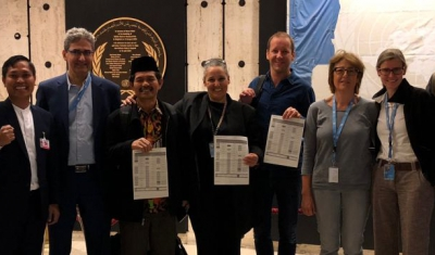 Academics and civil society holding the UN declaration after its adoption