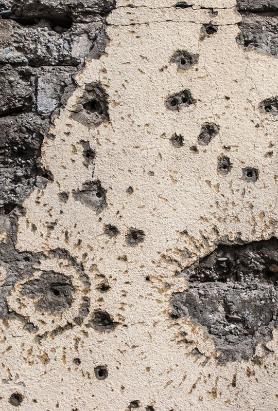 Masul, Iraq: a wall with bullet impacts. Mosul's old town experienced intense shelling, aerial bombing and attacks with improvised explosive devices (IED) during the conflict to retake the city from the Islamic State group in 2016/17.