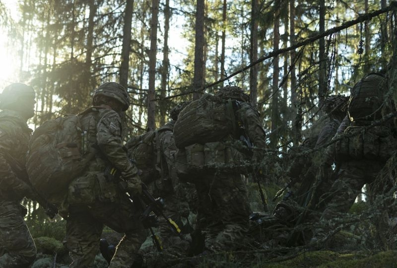 Troops from the Duke of Lancaster's Regiment working hard through the harsh Norwegian terrain as they extract a simulated casualty during FIWAF (fighting in woods and forests) training in Norway as part of Exercise Trident Juncture.