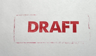 The word Draft written in red