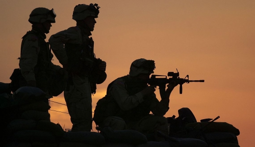 U.S. Army Soldiers from the 101st Airborne based at Fort Campbell, Ky., protect the