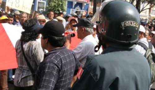 Peru, Lima. Anti-riot policemen during a demonstration.