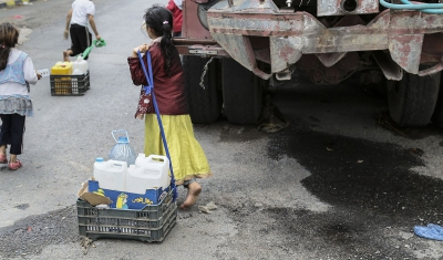 Yemen, Sana'a. Children seeking water, May 2015